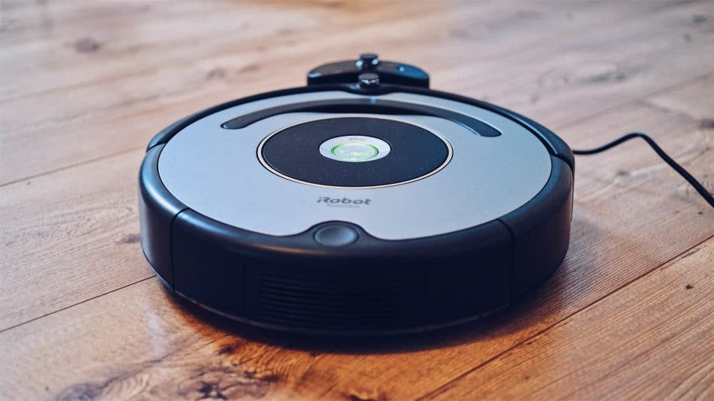 Picture of a robotic vacuum cleaner sweeping on the floor