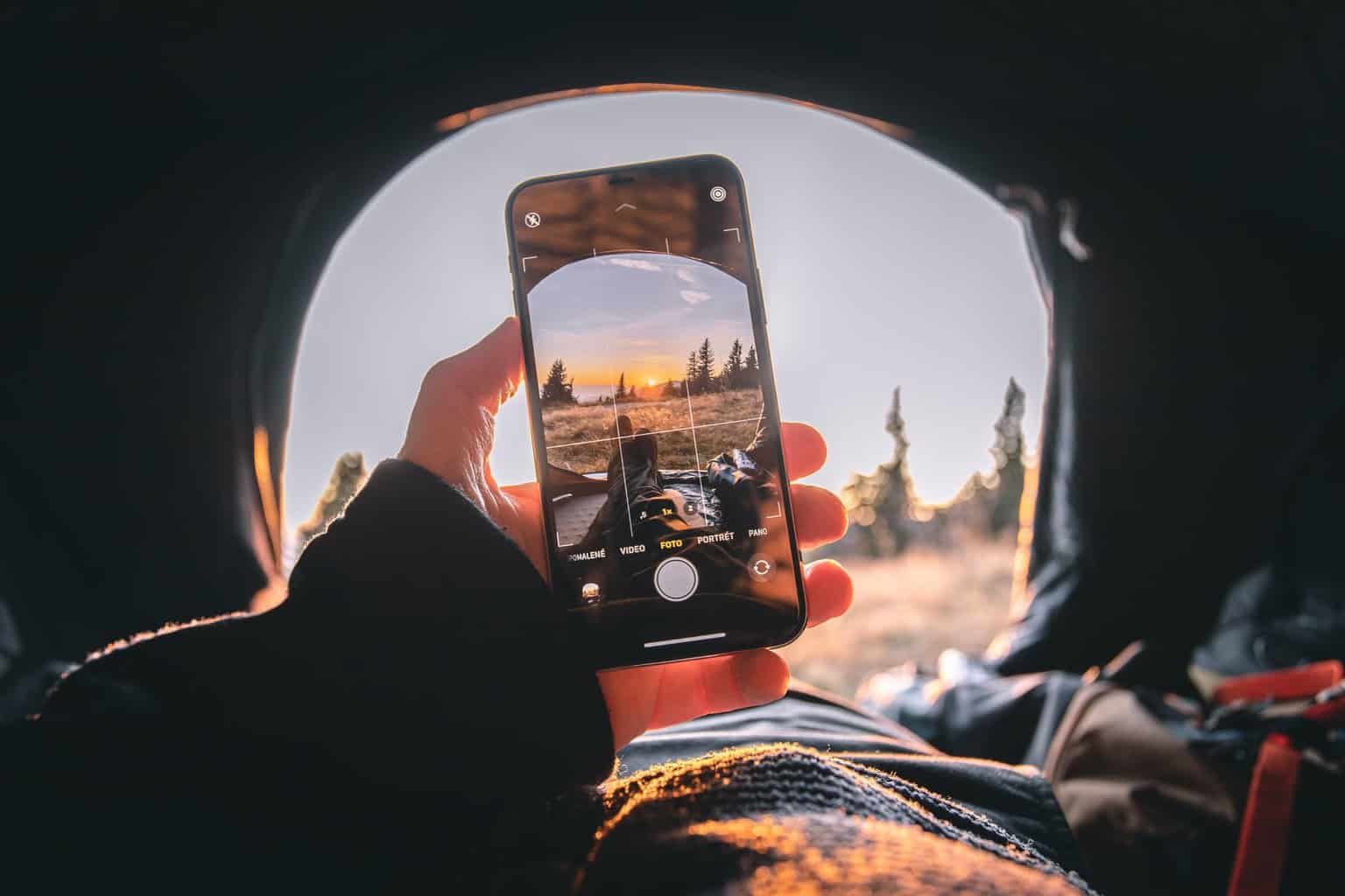 person capturing photo with an iPhone camera