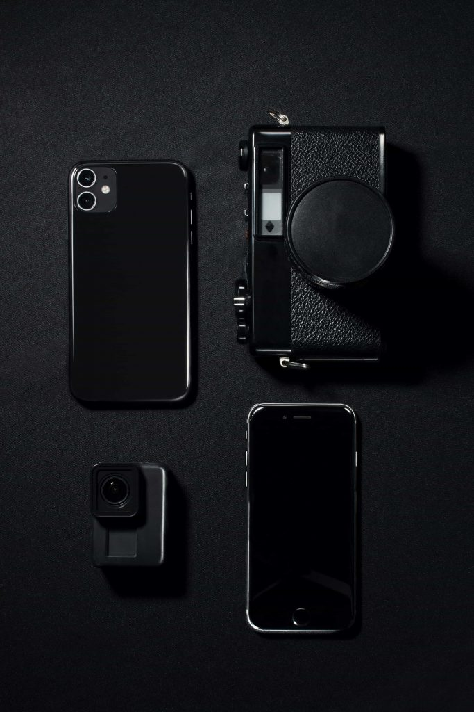 A picture showing iphone 11 camera along with a point and shoot camera